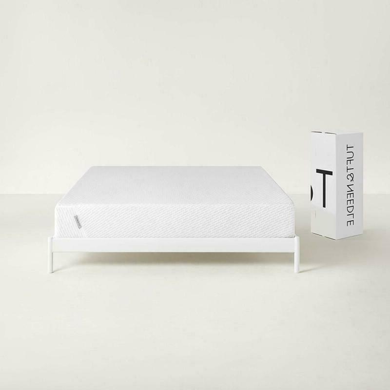 tuft needle queen mattress bed in a